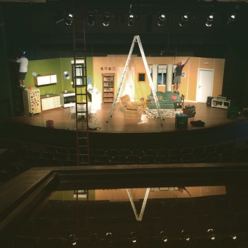 "Small stage set up for ""Coisas que Porto Alegre Fala at the Theater"""