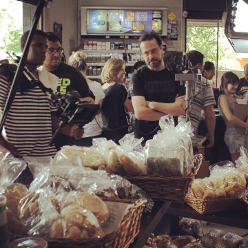 "Marco and DP Roberto Ricci at a local bakery shooting ""Coisas que Porto Alegre Fala"" television series"